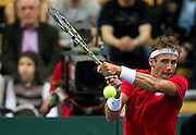 Lukasz Kubot of Poland competes in the second single man match during first day of the BNP Paribas Davis Cup 2013 between Poland and South Africa at MOSiR Hall in Zielona Gora on April 05, 2013...Poland, Zielona Gora, April 05, 2013..Picture also available in RAW (NEF) or TIFF format on special request...For editorial use only. Any commercial or promotional use requires permission...Photo by © Adam Nurkiewicz / Mediasport