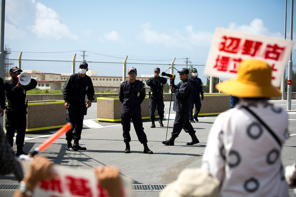 OKINAWA, JAPAN - JUNE 17 : Police observe the Anti U.S. Base protesters during a demonstration outside the Camp Schwab on June 17, 2016 in Nago, Okinawa, Japan. Protests have grown more intense in the past days due to the past incident of rape of a Japanese woman and drunk driving in Okinawa over American military presence in Japan. Photo: Richard A. de Guzman