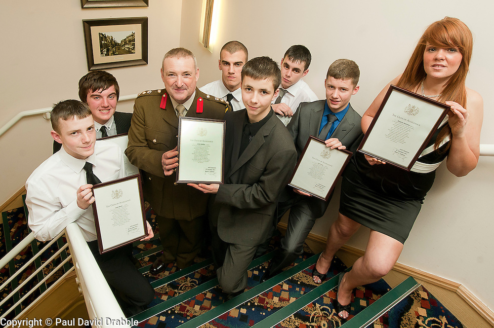 Army Prep course and Oath of Allegiance Doncaster taking the oath were James Brewin, Brian Blackborn, Kyle Walsh, Ashley McMillan, Josh Williams, Joel Tracey, Elizabeth MacSween pictured with Colonel JP Sykes Deputy Commander 15 (North East) Brigade...www.pauldaviddrabble.co.uk.7 December 2011  Image © Paul David Drabble