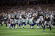 The Dallas Cowboys offensive line blocks during an extra point attempt as the Seattle Seahawks try to block the kick during the NFL football NFC wild card playoff game against the Seattle Seahawks on Saturday, Jan. 5, 2019 in Arlington, Tex. The Cowboys won the game 24-22. (©Paul Anthony Spinelli)