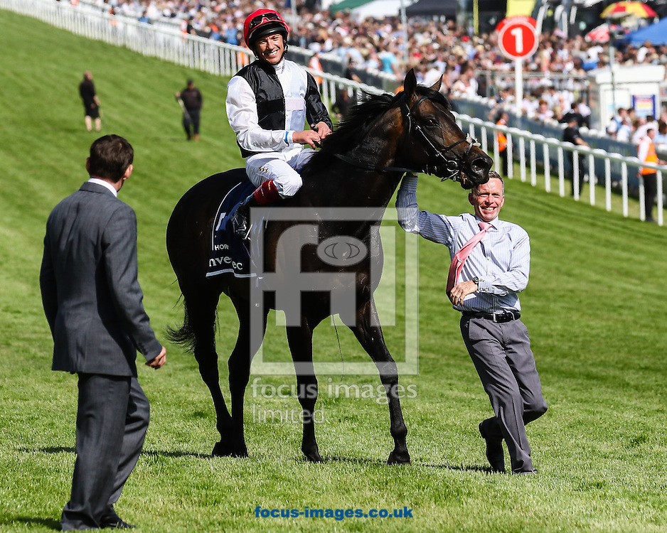 Frankie Dettori (Black/White,red) after winning his second Derby on 13-8 favourite Golden Horn on Derby Day at Epsom Racecourse, Epsom<br /> Picture by Mark Chappell/Focus Images Ltd +44 77927 63340<br /> 06/06/2015