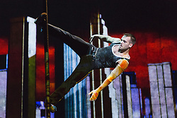 "© Licensed to London News Pictures. 30/09/2013. London, England. Pictured: Conor Neall on the Chinese Pole. The 15 performers from the Canadian troupe Cirque Éloize perform their show ""iD"" at London's Peacock Theatre from 1 to 19 October 2013. ""iD"" is a blend of circus arts and urban dance. Photo credit: Bettina Strenske/LNP"
