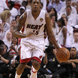 Jun 17, 2012; Miam, FL, USA; Miami Heat point guard Mario Chalmers (15) brings the ball down the court against the Oklahoma City Thunder during the third quarter in game three in the 2012 NBA Finals at the American Airlines Arena. Mandatory Credit: Derick E. Hingle-US PRESSWIRE