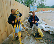 A survey team calculates the diameter for the record books.