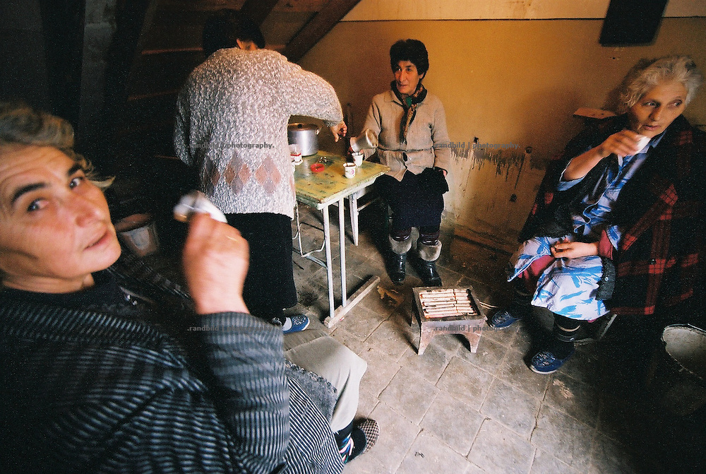 After some caretakers have finished to heat up cold classrooms in Winter in a west armenian school of Hoktember they sit together for a coffee break in the morning.
