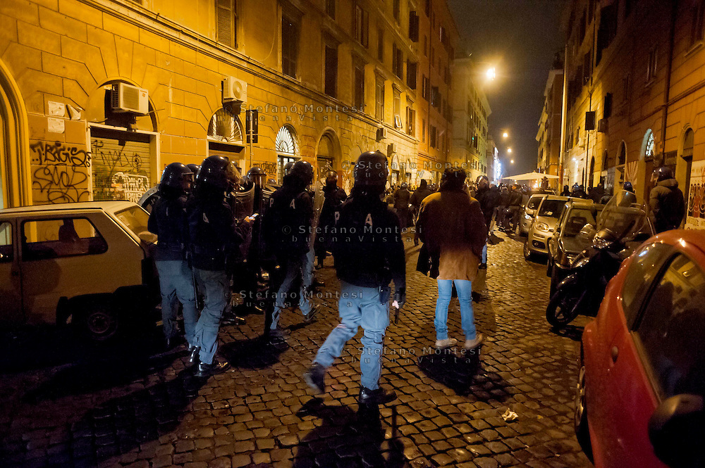 Roma 14  Dicembre  2013<br /> No Tav corteo al quartiere San Lorenzo per chiedere la liberazione dei quattro arrestati il 9 dicembre, scritte alla sede del Partito Democratico, interviene la polizia.<br /> Rome December 14, 2013<br /> No Tav demostration  at the San Lorenzo district to demand the release of the four arrested December 9,  writtens at the headquarters of the Democratic Party, the police intervene.
