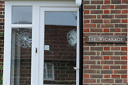 © Licensed to London News Pictures. 01/08/2012 . Smashed windows and blood can be seen at the Vicarage. Five people have been injured after a masked man armed with a machete broke into a church hall in Kent and attacked members of a singing group during their rehearsals. The man smashed the windows of St Paul's Cray, near Orpington, yesterday evening. The Metropolitan police spokesman said a 56-year-old man arrested for assault and criminal damage was being treated in hospital for a hand injury..Photo credit : Grant Falvey/LNP