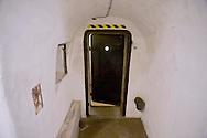 Roma 25 Ottobre 2014<br /> Aperti al pubblico i bunker segreti, costruiti tra il 1942 e il 1943,dove Benito  Mussolini e la sua famiglia cercava rifugio dai bombardamenti degli alleati nella residenza privata di Villa Torlonia. Nella foto: Il rifugio cantina, il prima ambiente adibito a rifugio antiaereo, attrezzato  intorno alla met&agrave; del 1940,  fu dotato di doppie porte blindate e di ,un sistema antigas di filtraggio, e rigenerazione dell&rsquo;aria, che veniva azionato a manovella,  un gabinetto, un telefono con linea diretta ad uso di Mussolini.<br /> Open to the public the secret bunkers built between 1942 and 1943, where Benito Mussolini and his family sought refuge from Allied bombing in the private residence of Villa Torlonia. <br /> Pictured: The cellar shelter,  the first air-raid shelter,built around the middle of 1940, was equipped with double doors armored  and a gas filtering system and regeneration air , that was operated crank, a toilet, a direct dial telephone for use by Mussolini.