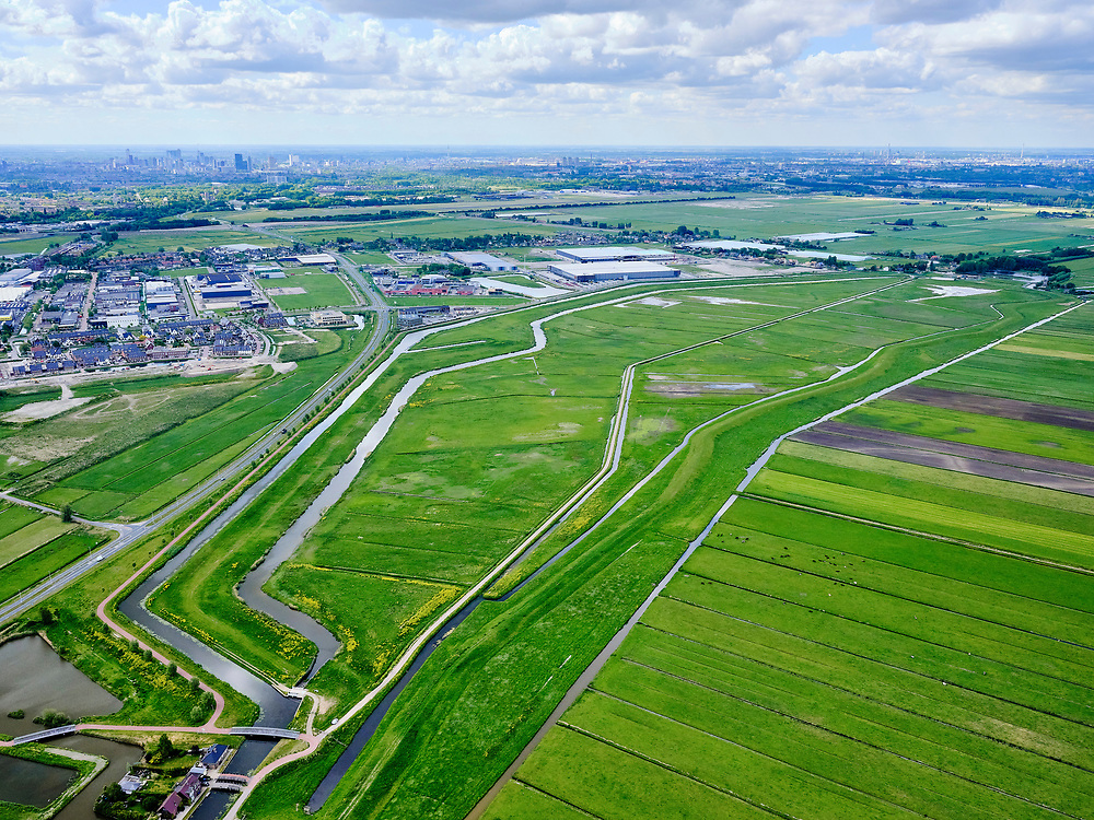 Nederland, Zuid-Holland, Pijnacker-Nootdorp; 14–05-2020; Bergboezem Polder van Oude Leede, ter hoogte van buurtschap Oude Leede, onderdeel van de Berkelse Boezem. De polder, met de Boezemweg,  is een natuurreservaat en tevens voorbestemd als waterberging ofwel een calamiteitenberging. Fotot richting Rotterdam Zestienhoven.<br /> Bergboezem Polder van Oude Leede, near the hamlet of Oude Leede, part of the Berkelse Bosom. The polder is a nature reserve and also destined as a water storage or a calamity storage.<br /> <br /> luchtfoto (toeslag op standaard tarieven);<br /> aerial photo (additional fee required)<br /> copyright © 2020 foto/photo Siebe Swart