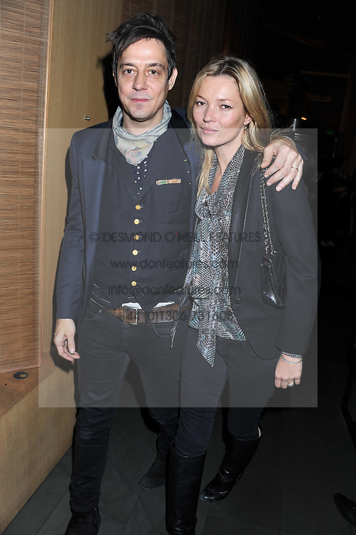 """KATE MOSS and JAMIE HINCE at a party to celebrate the launch of Meg Matthews' blog - """"Meg says"""" at the bar at Ni Ju San, 23 St.James's Street, London on 1st December 2011."""