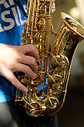 Closeup of a young boy playing a saxophone