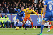 Sean Rigg of AFC Wimbledon is put under pressure from Michael Harriman of Wycombe Wanderers during the Sky Bet League 2 match between AFC Wimbledon and Wycombe Wanderers at the Cherry Red Records Stadium, Kingston, England on 21 November 2015. Photo by Stuart Butcher.