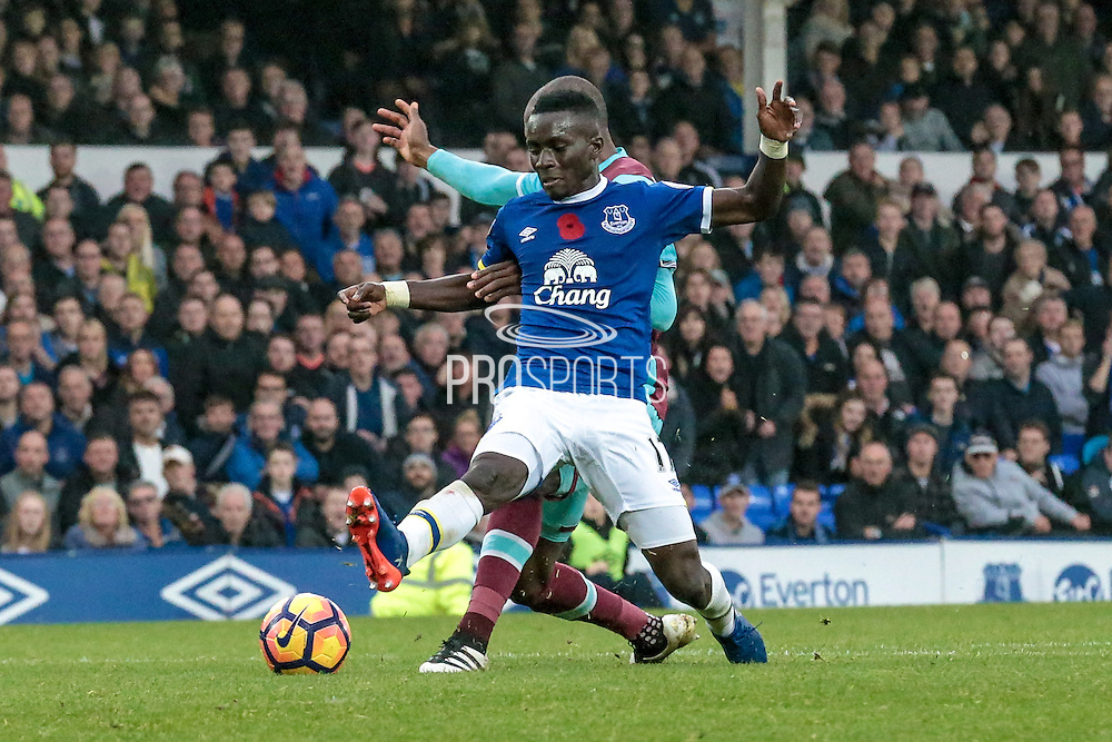Idrissa Gana Gueye (Everton) goes through for Everton and is blocked by Angelo Ogbonna (West Ham United). Everton claim a penalty but it is waved away during the Premier League match between Everton and West Ham United at Goodison Park, Liverpool, England on 30 October 2016. Photo by Mark P Doherty.