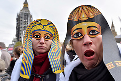 """© Licensed to London News Pictures. 31/10/2017. London, UK.  Women, many dressed up in 'mummy' costumes, take part in a """"March of the Mummies"""", marching from Trafalgar Square to Parliament Square to demand recognition, respect and change for working mothers.  Photo credit: Stephen Chung/LNP"""