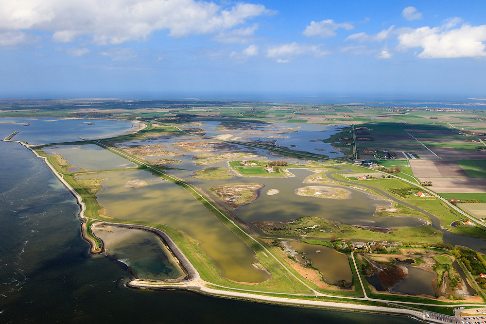 Nederland, Zeeland, Oosterschelde, 09-05-2013; inlagen ten zuiden van Serooskerke. Landinwaarts zijn polders onder water gezet in het kader van Plan Tuureluur. Links de Oosterschelde.<br /> Nationaal Park De Oosterschelde<br /> Land between the inner (original) dike and the sea dike near Serooskerke. Inland polders are inundated under the nature development project Tureluur. Oosterschelde left.<br /> luchtfoto (toeslag op standard tarieven);<br /> aerial photo (additional fee required);<br /> copyright foto/photo Siebe Swart.