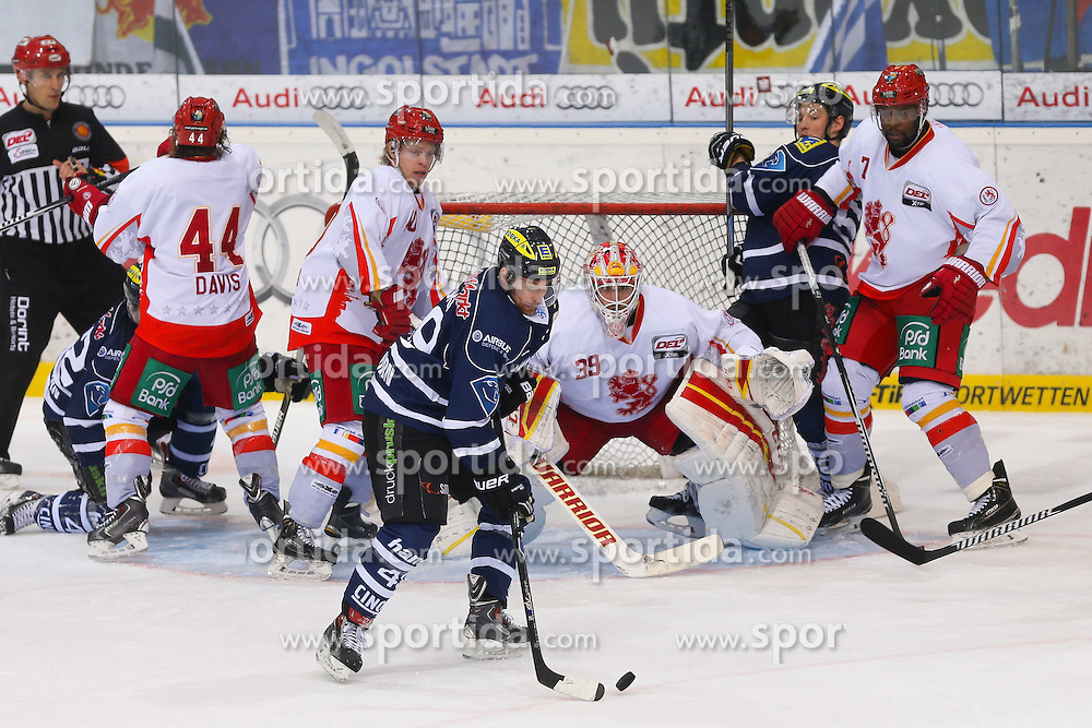 27.03.2015, Saturn Arena, Ingolstadt, GER, DEL, ERC Ingolstadt vs Duesseldorfer EG, Playoff, Halbfinale, 1. Spiel, im Bild Brendan Brooks (Nr.49, ERC Ingolstadt) vor Torhueter Tyler Beskorowany (Nr.39, Duesseldorfer EG) // during Germans DEL Icehockey League 1st semifinal match between ERC Ingolstadt and Duesseldorfer EG at the Saturn Arena in Ingolstadt, Germany on 2015/03/27. EXPA Pictures &copy; 2015, PhotoCredit: EXPA/ Eibner-Pressefoto/ Strisch<br /> <br /> *****ATTENTION - OUT of GER*****