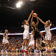 Skylar Diggins, Tulsa Shock, drives to the basket past Mistie Bass, (left) and Kelsey Griffin, Connecticut Sun, during the Connecticut Sun V Tulsa Shock WNBA regular game at Mohegan Sun Arena, Uncasville, Connecticut, USA. 2nd July 2013. Photo Tim Clayton