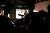 A man who could not make it onto the train tries to talk to a friend through the window at the train station in Jaipur City india Nov. 16, 2006 Jaipur India.    (photo by Darren Hauck)...................................
