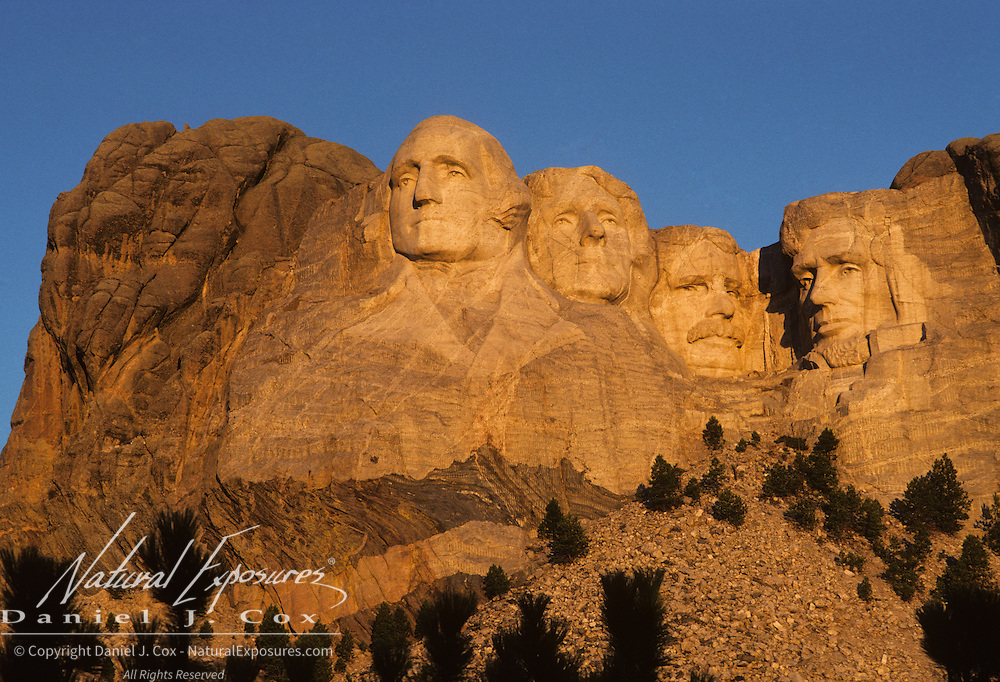 The faces of presidents Washington, Lincoln, Jefferson and Roosevelt on the Mount Rushmore National Memorial in the early morning hours. South Dakota