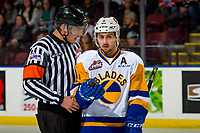 KELOWNA, CANADA - DECEMBER 1:  Max Gerlach #9 of the Saskatoon Blades speaks to referee Brayden Arcand on the ice against the Kelowna Rockets on December 1, 2018 at Prospera Place in Kelowna, British Columbia, Canada.  (Photo by Marissa Baecker/Shoot the Breeze)