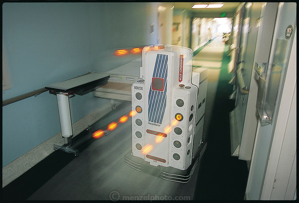 Whizzing around a hospital floor in Danbury, CT., HelpMate delivers patients' meal trays to hospital nurses. Now in healthcare facilities across the United States and in several other countries, the battery-operated, $100,000 HelpMate can transport food, drugs, and hospital wastes and even perform simple patient-care functions, such as guiding patients through hospital corridors. From the book Robo sapiens: Evolution of a New Species, page 186.