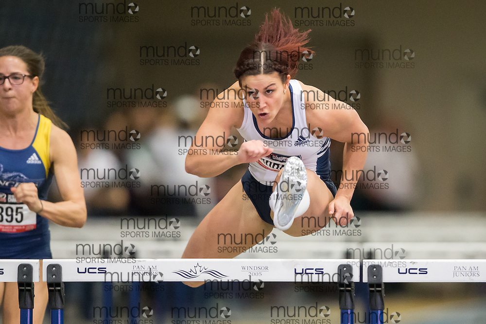 Windsor, Ontario ---2015-03-13--- Hayley Warren of Toronto runs to win the 60m hurdles at the 2015 CIS Track and Field Championships in Windsor, Ontario, March 13, 2015.<br /> GEOFF ROBINS/ Mundo Sport Images