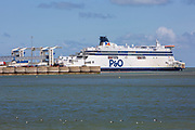 As P&O Ferries announce 1100 UK job losses after taking advantage of the government's furlough scheme due to the COVID - 19 outbreak, a P&O ferry in the Eastern Dock of the Port of Dover is where the cross channel port is situated with ferries departing here to go to Calais in France, on the 13th of May 2020 in Dover, Kent, United Kingdom. Dover is the nearest port to France with just 34 kilometres (21 miles) between them. It is one of the busiest ports in the world. As well as freight container ships it is also the main port for P&O and DFDS Seaways ferries. (photo by Andrew Aitchison)