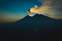 Aerial panorama of Fuego volcano blowing clouds of ash at sunset on Jan. 22, 2019 near Ciudad Vieja, Guatemala. To the right of Fuego's peak is the dormant Acatenango volcano.