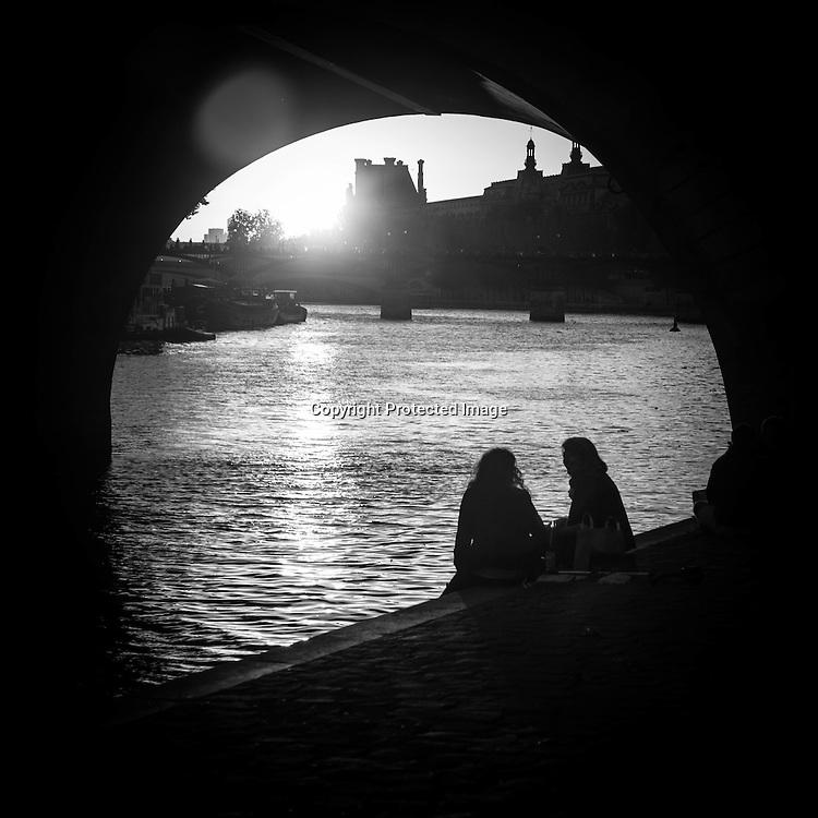 France. Paris people enjoying evening on the quay des orfevres, city island, by the seine river Paris France