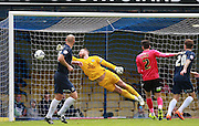 Peterborough United goalkeeper Ben Alnwick is unable to prevent Southend player Noel Hunt from heading the second goal for Southend during the Sky Bet League 1 match between Southend United and Peterborough United at Roots Hall, Southend, England on 5 September 2015. Photo by Bennett Dean.