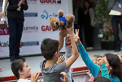 Young spectators fight for a toy bear, thrown by Katie Archibald (GBR), after Stage 3 of the Emakumeen Bira - a 77.6 km road race, starting and finishing in Antzuola on May 19, 2017, in Basque Country, Spain. (Photo by Balint Hamvas/Velofocus)