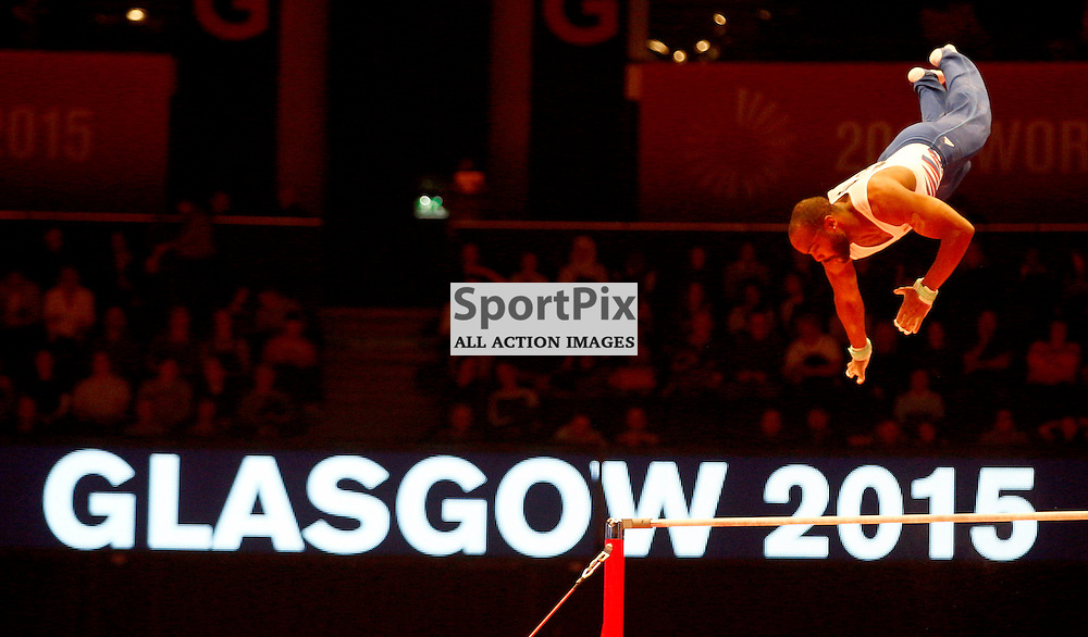 2015 Artistic Gymnastics World Championships being held in Glasgow from 23rd October to 1st November 2015.....Axel Augis (France) competing in the Horizontal Bar competition..(c) STEPHEN LAWSON | SportPix.org.uk