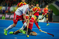 England's David Condon is tackled by Bosco Perez Pla of Spain. England v Spain - Unibet EuroHockey Championships, Lee Valley Hockey & Tennis Centre, London, UK on 25 August 2015. Photo: Simon Parker
