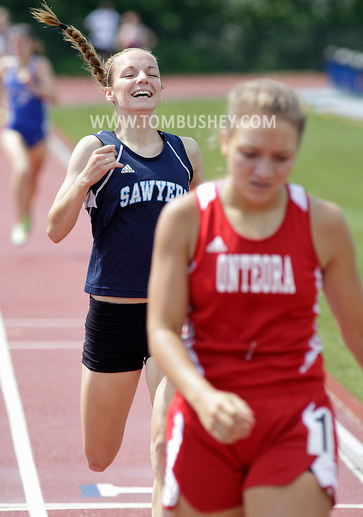 Shannon Averill of Saugerties smiles after finishing second to Onteora's Emily Waligurski at the Section 9 track and field state qualifying meet in Middletown on Thursday, May 30, 2013. Both runners qualified for the state meet.