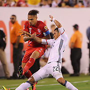 EAST RUTHERFORD, NEW JERSEY - JUNE 17:  Jose Paolo Guerrero #9 of Peru is tackled by Jeison Murillo #22 of Colombia during the Colombia Vs Peru Quarterfinal match of the Copa America Centenario USA 2016 Tournament at MetLife Stadium on June 17, 2016 in East Rutherford, New Jersey. (Photo by Tim Clayton/Corbis via Getty Images)
