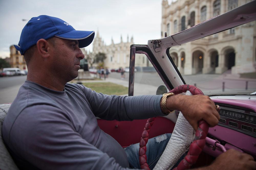 Convertible taxi driver in Havana, Cuba.