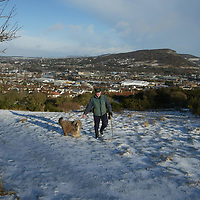 A man takes a walk on Craigie Hill overlooking Perth. The predicted bad weather has avoided the area with only a light dusting of snow. The hill pictured centre is Kinnoull Hill.<br />