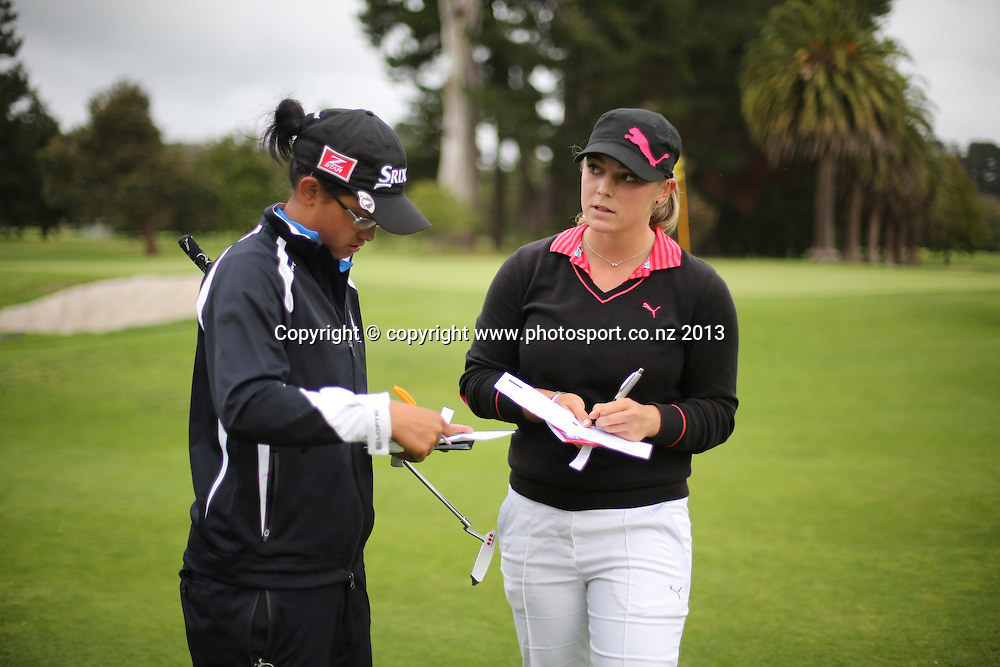 Hanna Seifert and Julianne Alvarez on the final day of the 2013 New Zealand Amateur Championship, Manawatu Golf Club, Palmerston North, New Zealand. Sunday 26 April 2013. Photo: John Cowpland / photosport.co.nz