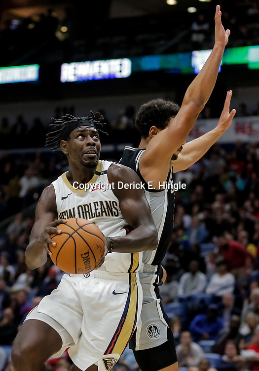 Nov 19, 2018; New Orleans, LA, USA; New Orleans Pelicans guard Jrue Holiday (11) drives past San Antonio Spurs guard Bryn Forbes (11) during the second quarter at the Smoothie King Center. Mandatory Credit: Derick E. Hingle-USA TODAY Sports