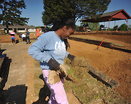 Volunteer Neci Dismukes helps place sod at Rivers Hill Park in Oxford, Miss. on Monday, April 22, 2013.