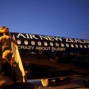 Passengers board the Air New Zealand's all-black A320 plane for domestic routes, The aircraft, painted black with a silver fern to mark the airline's sponsorship of the All Blacks. New Zealand is host of this years Rugby World Cup.  Auckland. New Zealand. 7th August 2011. Photo Tim Clayton