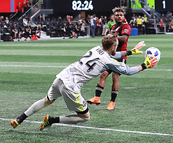 July 15, 2018 - Atlanta, GA, USA - Seattle Sounders goalkeeper Stefan Frei blocks a shot as Atlanta United midfielder Josef Martinez looks on during the second half on Sunday, July 15, 2018, in Atlanta, Ga. (Credit Image: © Curtis Compton/TNS via ZUMA Wire)
