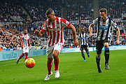 Stoke City Forward Jonathan Walters takes on Newcastle United Defender Paul Dummett  during the Barclays Premier League match between Newcastle United and Stoke City at St. James's Park, Newcastle, England on 31 October 2015. Photo by Craig McAllister.
