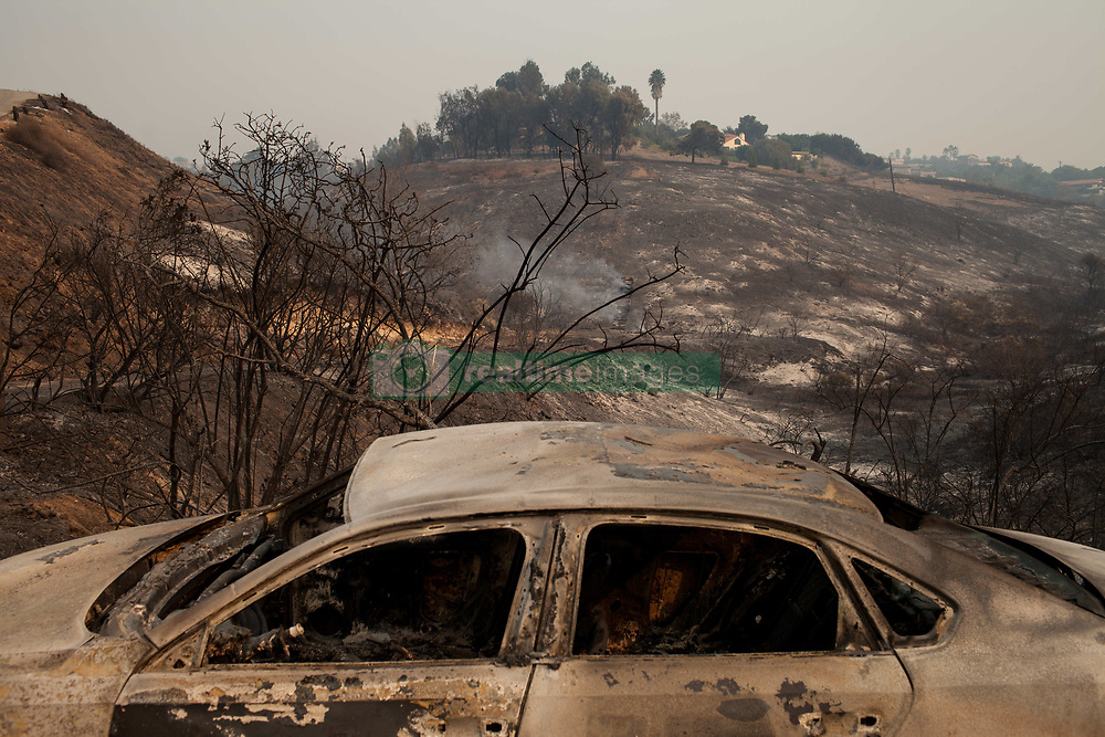 November 10, 2018 - Malibu, California - A vehicle and mountainside along the Pacific Coast Highway were burnt during the Woolsey Fire in Malibu, California. The Woolsey fire doubled in size overnight with 70,000 acres burned forcing nearly 95,000 residents to evacuate their homes in Los Angeles and Ventura counties as of Saturday morning according to Cal Fire. (Credit Image: © Joel Angel Juarez/ZUMA Wire)