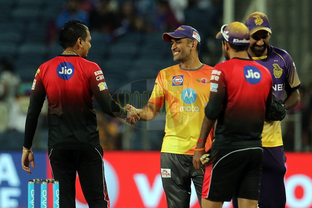 MS Dhoni of Rising Pune Supergiant shake hands with Sunil Narine of the Kolkata Knight Riders before the start of the match 30 of the Vivo 2017 Indian Premier League between the Rising Pune Supergiants and the Kolkata Knight Riders  held at the MCA Pune International Cricket Stadium in Pune, India on the 26th April 2017<br /> <br /> Photo by Vipin Pawar- IPL - Sportzpics