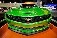"A Chevy Camero ""Hot Wheels"" edition with green chrome paint at the 2011 LA Auto Show."