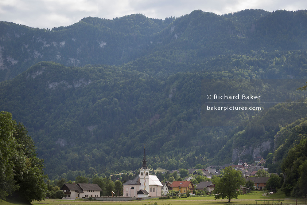 A rural Slovenian community church and village near Lake Bled, on 18th June 2018, in Bohinjska Bela, Bled, Slovenia.