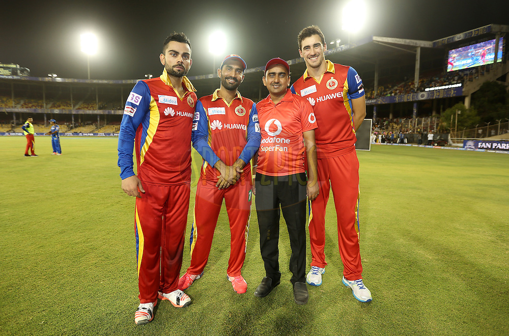 Royal Challengers Bangalore captain Virat Kohli, Royal Challengers Bangalore player Dinesh Karthik and Royal Challengers Bangalore player Mitchell Starc with the Vodafone fan during the presentation of the match 22 of the Pepsi IPL 2015 (Indian Premier League) between The Rajasthan Royals and The Royal Challengers Bangalore held at the Sardar Patel Stadium in Ahmedabad , India on the 24th April 2015.<br /> <br /> Photo by:  Sandeep Shetty / SPORTZPICS / IPL