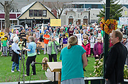 Bar Harbor, USA. 29 April, 2017. Bo Greene of Indivisible MDI introduces Brian Hubbell, Maine House of Representatives, as protesters gather on the Village Green for the Downeast Climate March, a sister march to the People's Climate March in Washington, D.C.
