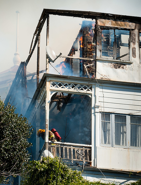 A house in Allenby Terrace is engulfed in flames in central Wellington, New Zealand, Wednesday, September 14, 2011. Credit:SNPA / Mark Coote.